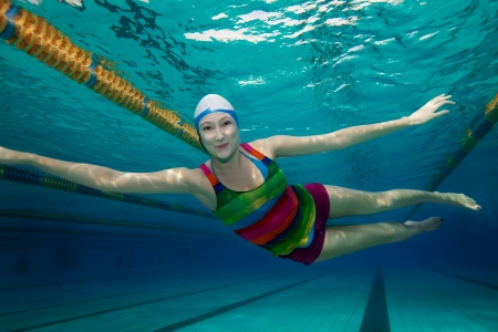 swimming shorts: Girl swimming in the pool - underwater shoot