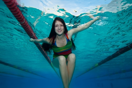 swimming shorts: Happy girl in the pool - view from bellow