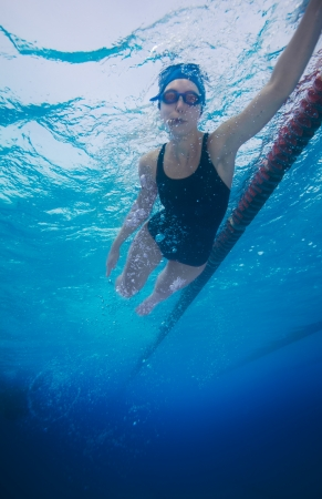 swimming underwater: Underwater shoot of a professional sportsman swimming in crawl style Stock Photo