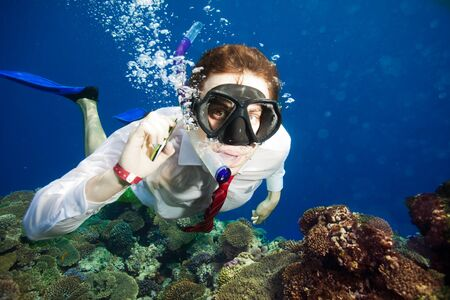 Available by cell phone everywhere -  even underwater - man having a conversation underwater photo