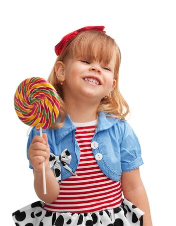 Happy girl smiling and holding lollipop, isolated on white background photo