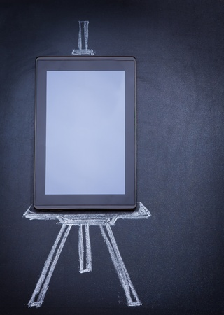 Tablet computer as easel on the blackboard with tripod and strobe drawn with chalk photo