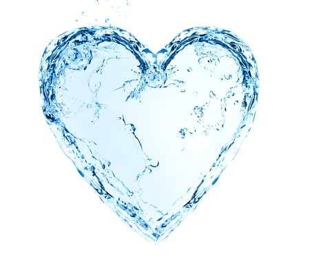 Heart made of water splashes on blue photo