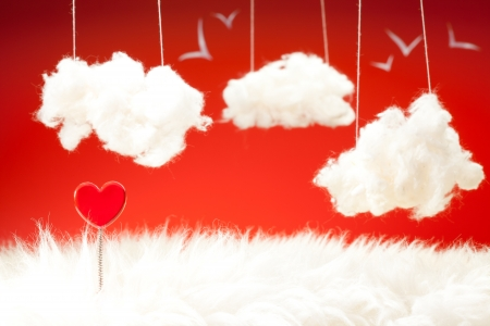 cotton wool: Valentine day theme with red heart on a spring clouds from cotton wool