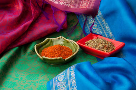 Indian spices with in the plates on the Indian traditional scarf's Stock Photo - 13949273