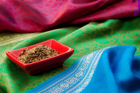 Close-up of spices with in the plates on the Indian traditional fabric Stock Photo - 13949116