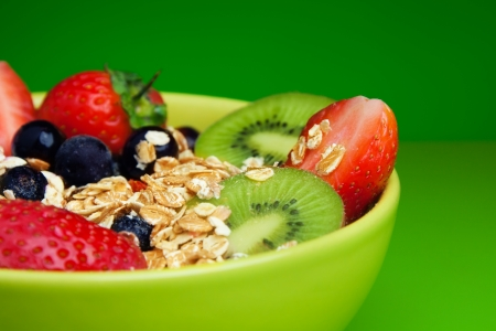 Bowl with muesli and fresh berries and fruits
