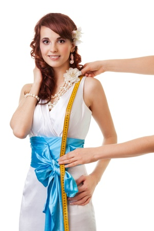 Measuring length from waist to shoulder of a bride for a wedding dress Stock Photo - 13947849