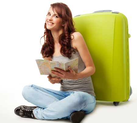 hard to find: Happy girl with map and luggage and with big smile on her face Stock Photo