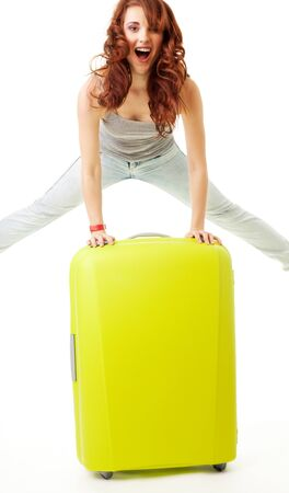 Vacation finally - girl jumping on the green luggage bag