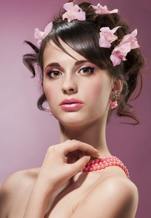 Beauty shoot of woman with pink spring flowers in hairstyle Stock Photo - 13948147