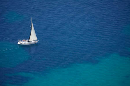 bird eye view: yacht with white sail from high angle view Stock Photo
