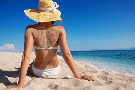 sit shape: beautiful woman relaxing on sandy beach alone