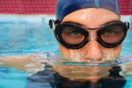 submerging: swimmer woman in action submerging in pool Stock Photo