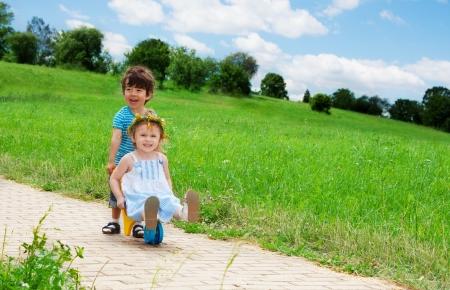 carting: girl carting her brother Stock Photo