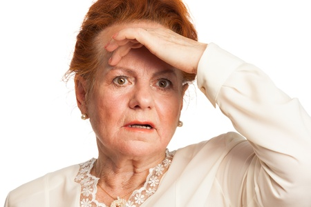 Confused senior woman experiencing memory loss photo