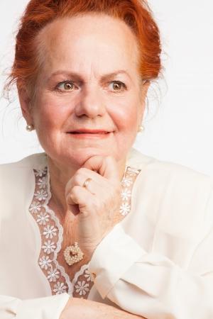 Thoughtful senior lady isolated on white Stock Photo - 16708500