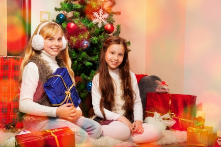 Two sisters preparing Christmas presents photo