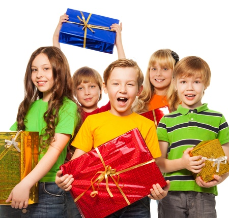 Happy kids with Christmas presents isolated on white photo