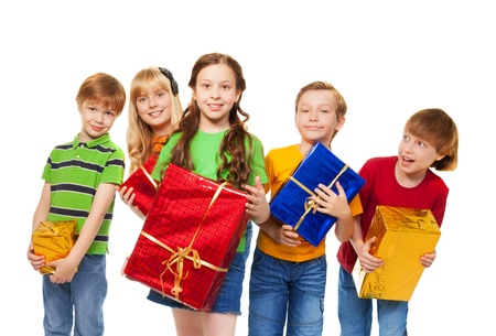 8 years birthday: Cute kids with wrapped boxes on Christmas party