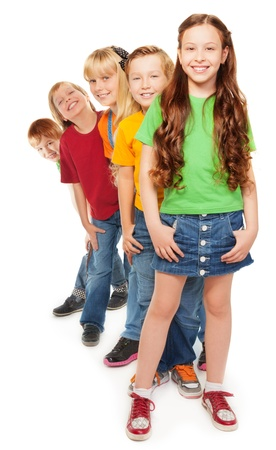 Group of 5 boys and girls standing in a line with smile on their faces Stock Photo