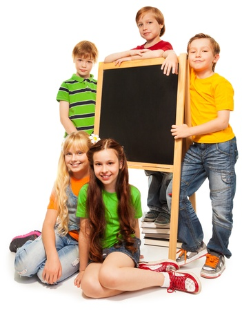 group study: Five cute school kids with blackboard isolated on white