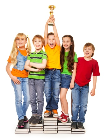 Shouting kids standing on books piles