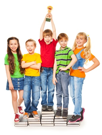 Five happy kids in colorful shirts with bowl cheering as they win photo