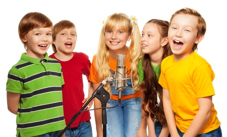 child singing: Classmates singing together standing with microphone