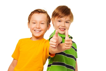 two thumbs up: Cute boys with thumbs up isolated on white