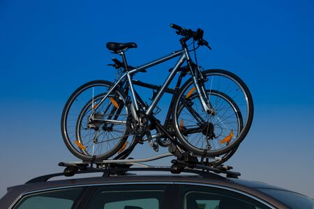 mounted: Bike transportation - two bikes on the roof of a car