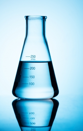 Big lab flask close-up with blue liquid and grades up to 250 ml photo
