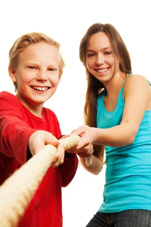 team of 11 years old blond boy and older girl pulling the rope in competition Stock Photo - 17420406
