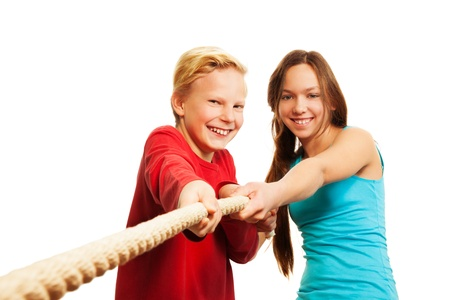 Two kids pulling the rope - boy and girl, together isolated on white photo