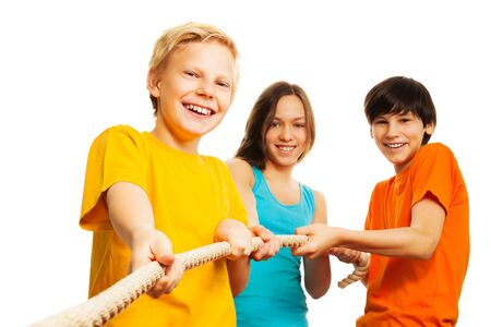 Three kids pull the rope with smile on their face Stock Photo - 17420393