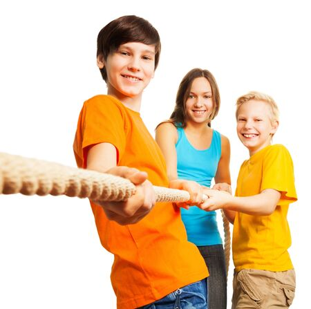 Team concept three happy kids pull the rope Stock Photo - 17420421
