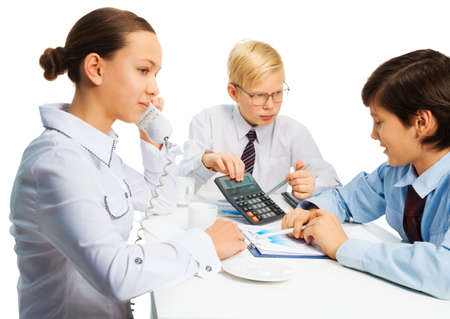 Smart kids playing to be and adults sitting by the table and discussing business Stock Photo - 17420729