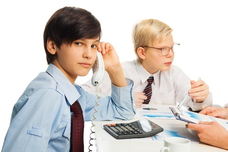 Two kids pretending to be adult sitting in office and doing job chores Stock Photo - 17420752