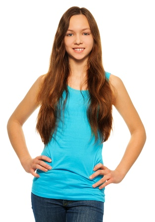 Portrait of young teen girl standing on white and smiling Stock Photo - 17420748