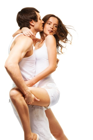 closeness: Attractive couple in intimate dance hugging and kissing Stock Photo