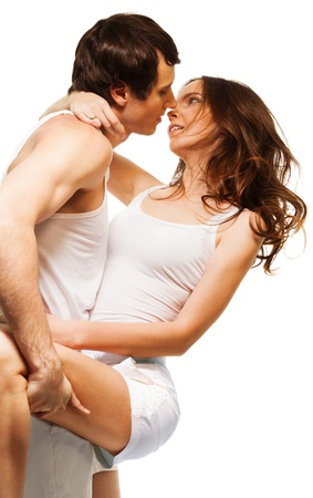 Young attractive couple dancing and about to kiss in intimate pose photo