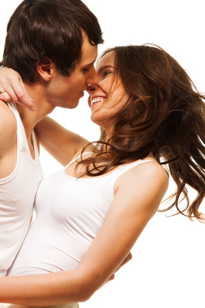 Beautiful attractive laughing girl smiling and kissing his boyfriend Stock Photo - 17420917