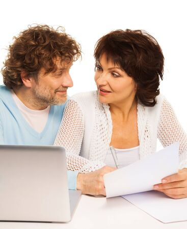 Senior adults discussion business with papers and laptop Stock Photo - 17421798