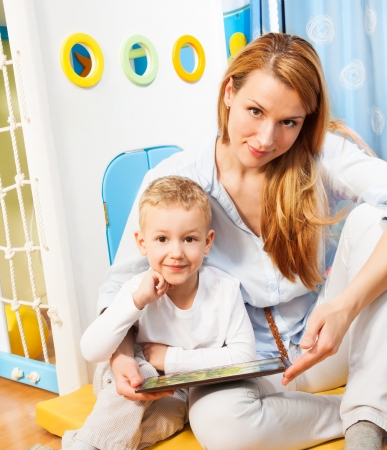 Mother and son playing with tablet computer together in the beedroom Stock Photo - 17421797