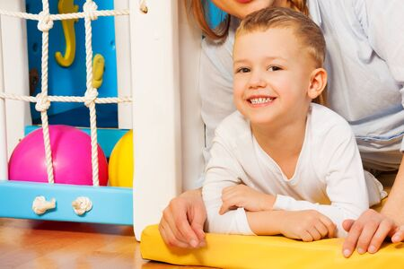 Happy mother and her five years old kid laying on the floor with just drawn picture Stock Photo - 17421810