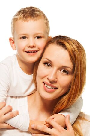 Happy mother with her little son smiling  and hugging isolated on white photo