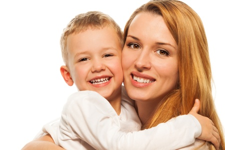 Happy parenting - smiling and laughing young mother with five years old blond son Stock Photo - 17421805