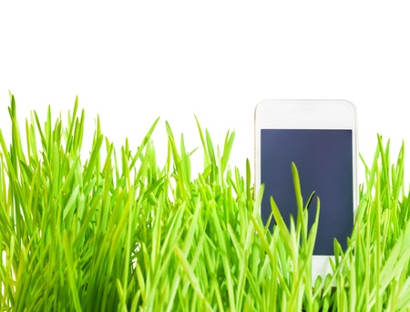 call of nature: Smart phone in the grass with touch screen cell phone in it