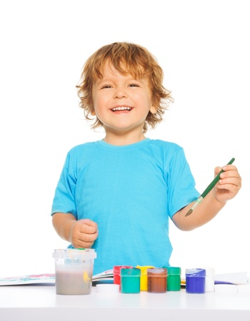 Happy smiling kid painting with paintbrush and colorful vivid colors, smiling, isolated