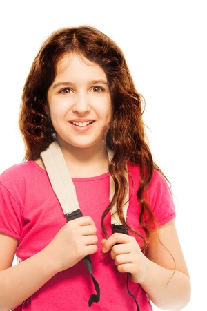 arab teen: Portrait of happy 11 years old girl with backpack and curly hair isolated on white